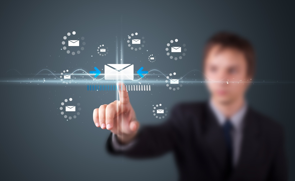Businessman pressing messaging type of modern icons with virtual background.jpeg