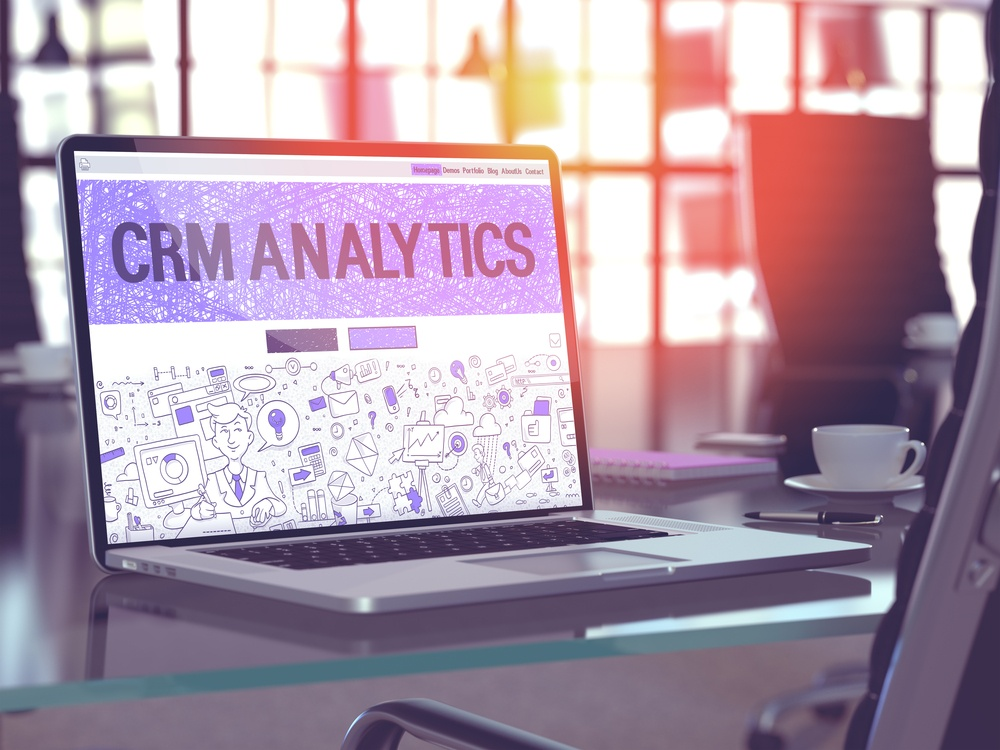 CRM Analytics - Closeup Landing Page in Doodle Design Style on Laptop Screen. On Background of Comfortable Working Place in Modern Office. Toned, Blurred Image. 3D Render..jpeg