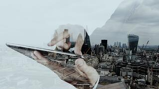 Double exposure of businessman working with new modern computer and london city background as concept.jpeg