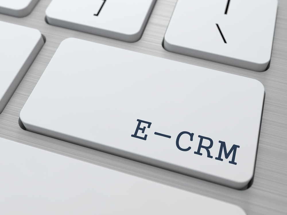 E-CRM. Information Technology Concept. Button on Modern Computer Keyboard. 3D Render..jpeg