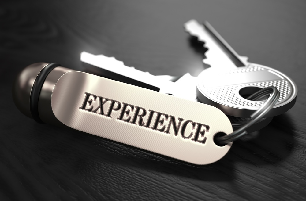Experience Concept. Keys with Keyring on Black Wooden Table. Closeup View, Selective Focus, 3D Render. Black and White Image..jpeg