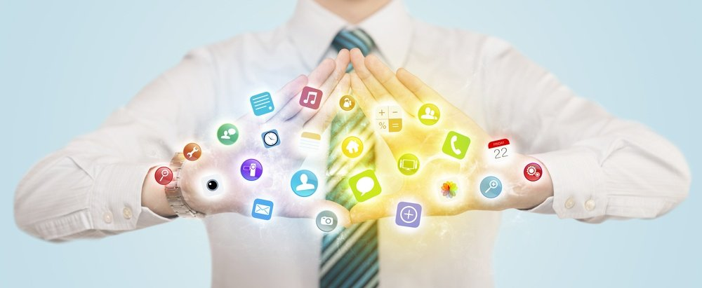Hands creating a form with colorful mobile app icons in the center.jpeg