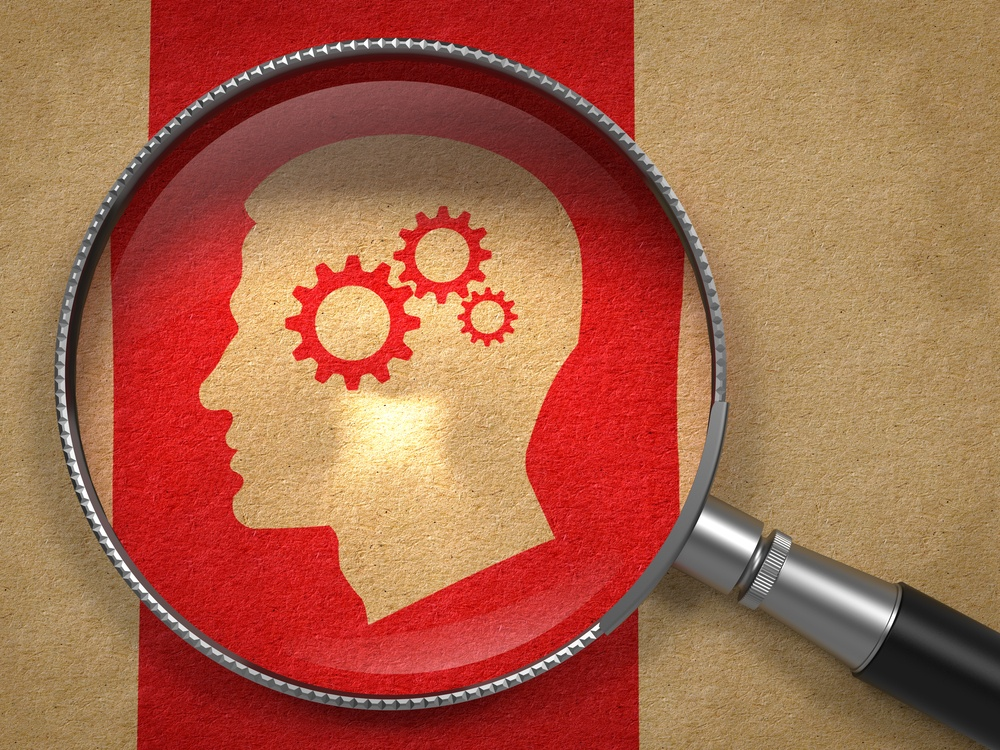 Magnifying Glass with Icon of Profile of Head with Cogwheel Gear Mechanism on Old Paper with Red Vertical Line Background..jpeg
