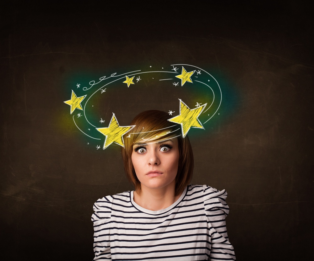 Young girl with yellow stars circleing around her head illustration.jpeg