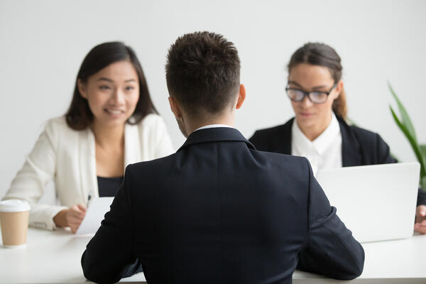 shutterstock_1060846622Male job applicant being interviewed by diverse HR representatives team discussing his work experience, sharing thoughts during recruitment process in company office. Concept of hiring, employment